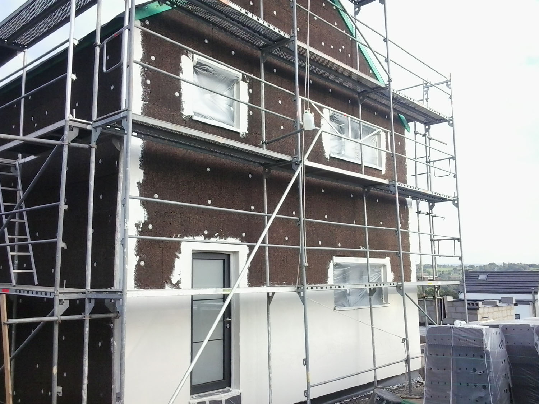 Isolation de la façade en isoliège recouvert par un crépi